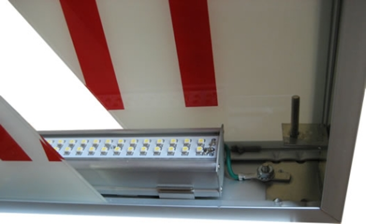 Radionic LED retrofit exit sign kit reduces electricity costs in municipal and commercial buildings
