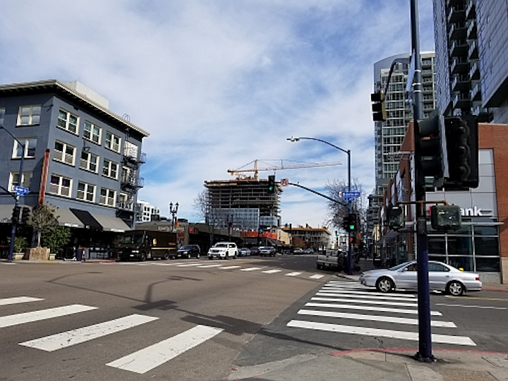FIG. 1. San Diego is installing the Current CityIQ nodes on both cobrahead and decorative gaslamp-style poles with LED luminaires. The busy Market Street includes both types, and with two lanes of traffic in each direction and a turn lane, the sensor nodes with two-way cameras line both sides of the street. (Photo credits: All photos, Maury Wright.)