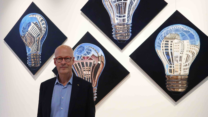 Good Light Group chairman Jan Denneman is a man on a nutritional light mission. He lives, breathes and even paints light, such as his reflecting bulb artwork hanging at Signify headquarters in Eindhoven. (Photo credit: Image courtesy of Jan Denneman.)