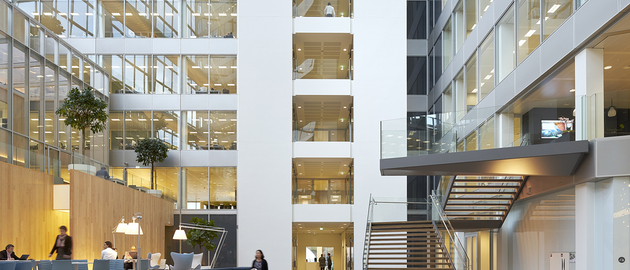 FIG. 1. The newly-built Edge building in Amsterdam is known for its IoT backbone and the ubiquitous deployment of Power over Ethernet as a backbone that enables advanced applications such as space optimization, but building retrofits need the flexibility of a wireless network and a standard intra-luminaire bus can enable flexible choices in inter-luminaire connectivity. (Photo credit: Image courtesy of Deloitte Group, photographer Ronald Tilleman; http://tilleman.nl.)
