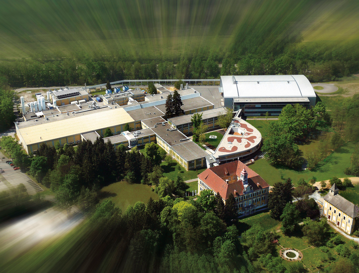 AMS headquarters and a fabrication plant sit on the grounds of an old Austrian castle, about a four-hour drive from Osram in Munich. (Photo credit: Image by user LKMKL on Wikimedia Commons, used under Creative Commons license for editorial purposes - https://commons.wikimedia.org/wiki/File:AMS_aerials2007.jpg.)