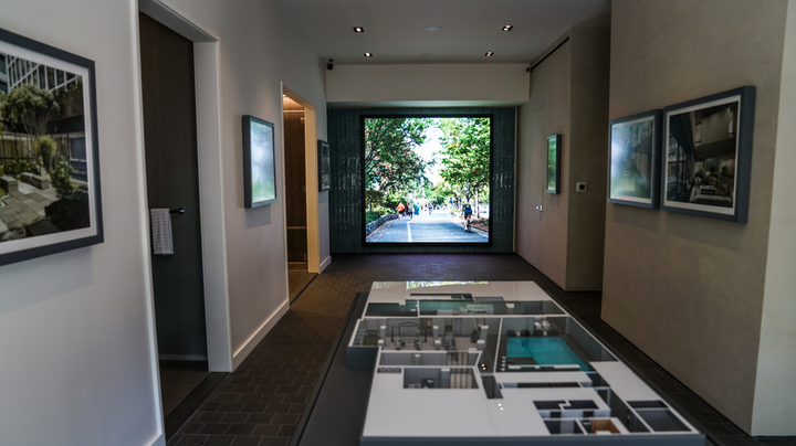 A large-scale immersive LED display by PixelFLEX enhances the home buying experience in a New York home builder's office. (Photo credit: Image courtesy of PixelFLEX.)