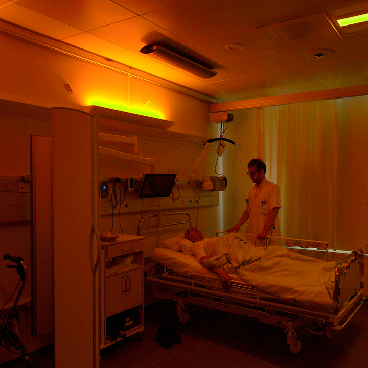 A stroke patient under soft warm nighttime lighting at Righospitalet, with neurologist Anders West of the University of Copenhagen. (Photo credit: Image courtesy of Chromaviso.)