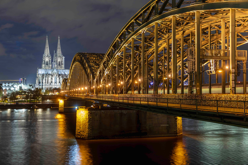 It will take 15 years to replace and connect all of Cologne's 85,000 outdoor light points, but these lights on the city's Hohenzollern Bridge over the Rhine (above), as well as those in the public area featuring the equestrian statue of Kaiser Wilhelm II (below) are among the new installations completed so far in the 2,000+-year-old city, which is today's Germany fourth largest by population. (Photo credit: Images courtesy of Signify.)